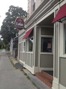 The entrance to Lola's Cafe & Gourmet Catering on Washington Ave.