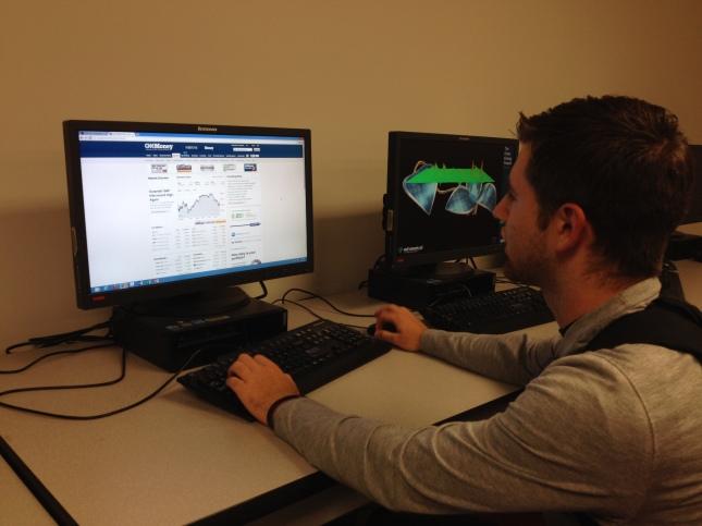 Marist College student Matthew Hunt reviews current stock trends online.