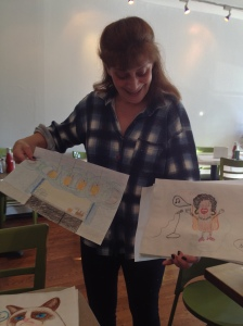 Souldog manager Janet Morris displays her favorite customer-art.
