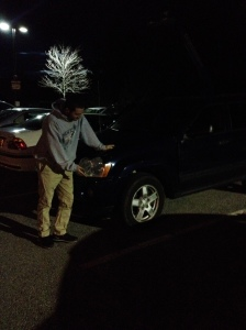 Sophomore Ben Hayes stands next to his car, which suffered a flat tire right before he planned to head home.