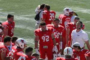 Nick Pititto #92 listens into the defensive huddle