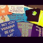 An assortment of FitzU t-shirts designed for female athletes. Photo provided by Rachele Fitz.