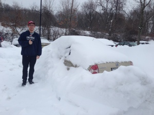 A Marist student (now a graduate) gets ready to shovel out his girlfriends car. Photo by Bob Tognetti