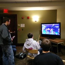 A group of students enjoying a game of Rock Band