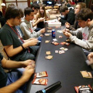 A group of students playing Magic: The Gathering