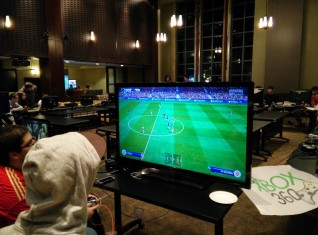 Students participating in a Fifa 15 tournament