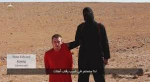 ISIS member with Peter Kassig. Courtesy of the NY Daily News