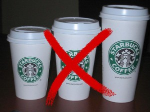 Three Starbucks cups with a big X through the middle one.