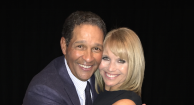 Katie Couric hugging friend Bryant Gumbel after he receives his award.