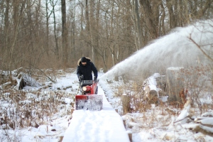 Patrick clearing snow from the nature trail last January