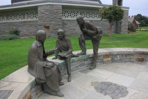 A statue of two Marist students speaking with Marcellin Champagnat, the founder of the Marist Brothers, is located adjacent to the Marist chapel.