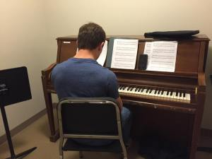 Student, William Ryan, practices for his beginner piano class. Photo by Sarah Gabrielli