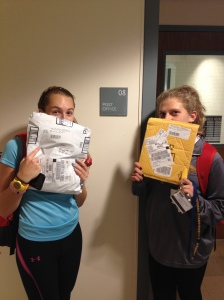 Jordan Casey and Shea Bonham picking up their packages after cross country practice.