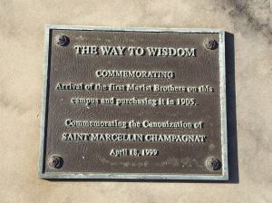 The Way to Wisdom plaque next to the statue. Original photo by Dylan Gordon