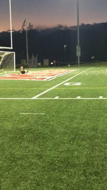 Siena goalkeeper Leslie Adams deflects shots taken at her during pregame.