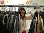 Founder Caroline Ricci sorting clothing to post on the store's Instagram account, @OldNewzz.